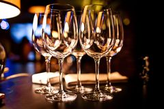 Empty glasses set in restaurant Royalty Free Stock Image