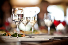 Empty glasses set in restaurant Stock Images