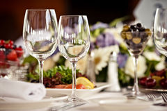 Empty glasses set in restaurant Royalty Free Stock Images