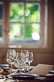 Empty glasses set in restaurant Stock Photography