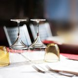 Empty glasses set in restaurant with wine glasses and plates for. Food. Served for a dinner table setting close up stock photos