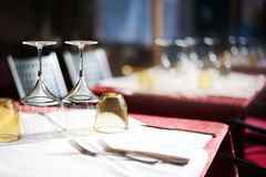 Empty glasses set in restaurant with wine glasses and plates for. Food. Served for a dinner table setting royalty free stock photos