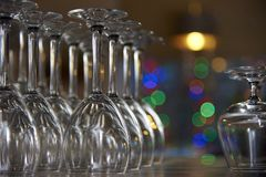Empty glasses on a shelf royalty free stock photos