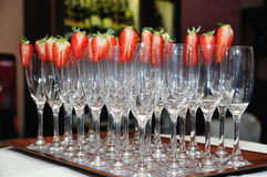 Empty glasses with strawberries Stock Image