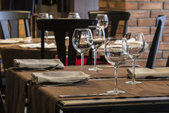 Empty glasses on a table in restaurant royalty free stock image