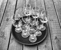 Empty glasses on a tray, black and white photo Stock Photo