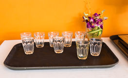 Empty glasses on the tray Royalty Free Stock Image