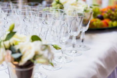 Empty glasses on the white table, A row of empty champagne glass Stock Photo
