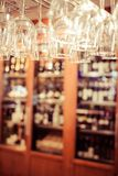 Empty glasses for wine above a bar rack Royalty Free Stock Photos