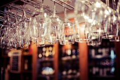 Empty glasses for wine above a bar rack Stock Image