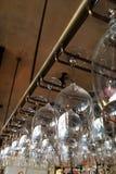 Empty glasses for wine. Above a bar rack. Restaurant, interior stock image