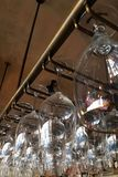 Empty glasses for wine. Above a bar rack. Restaurant, interior royalty free stock photos