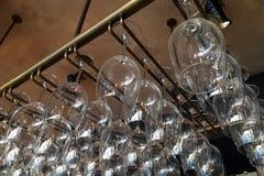 Empty glasses for wine. Above a bar rack. Restaurant, interior stock photo