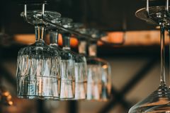 Empty glasses for wine above a bar rack in vintage. Tone Royalty Free Stock Photo