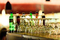 Empty glasses for wine on a bar rack Stock Photography