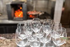 Empty glasses wine in restaurant. Glass water. A tray of wine glasses at a wedding reception Royalty Free Stock Image