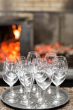 Empty glasses wine in restaurant. Glass water. A tray of wine glasses at a wedding reception Royalty Free Stock Images