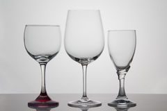Empty glasses of wine on white background Royalty Free Stock Photos