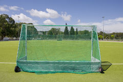 Empty goal back view. Green grass and empty goal back view at an outdoor playing field Royalty Free Stock Images