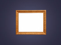 Empty gold frame on blue wall Stock Photography