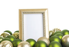 Empty Gold Frame with Christmas Ornaments on a White Background Stock Images