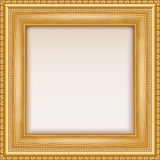 Empty gold frame hanging on the wall. Stock Photo