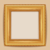 Empty gold frame hanging on the wall Royalty Free Stock Image