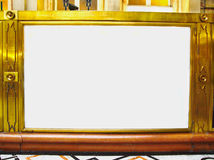 Empty golden antique frame with white empty center Stock Photos