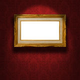 Empty golden frame on the wall. stock photos