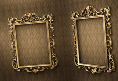 Empty golden frames on the wall. Royal. Empty golden frames on the wall. Space showroom. Royal Stock Images
