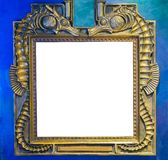 Empty golden painting or mirror frame decorated with seahorse animals to put what ever you want on the empty white space royalty free stock photos