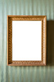 Empty golden picture frame on the wall Royalty Free Stock Image