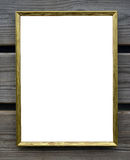 Empty golden picture frame on wooden wall Royalty Free Stock Images