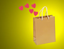 Empty golden valentines gift bag. Royalty Free Stock Images