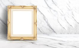 Empty golden vintage frame at white clean marble wall and floor Stock Image