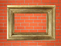 Empty golden wooden frame on the brick wall Royalty Free Stock Photography