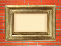 Empty golden wooden frame on the red brick wall Royalty Free Stock Photos