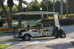 Empty golf cart sitting on a macadam path by a. Empty golf cart on a macadam path by a golf course, Florida, Kissimmee Stock Photo