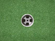 Empty golf cup on green grass Royalty Free Stock Photo