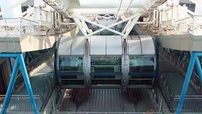 Empty gondola of rotating Ferris wheel stock footage