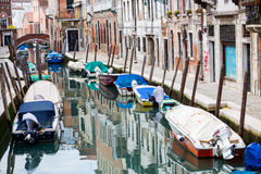 Empty gondolas moored along water canal Stock Photo