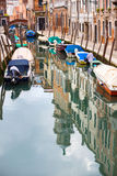 Empty gondolas moored in water canal Stock Photo