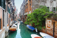 Empty gondolas parked in water canal Royalty Free Stock Photo