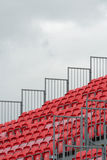 Empty grandstand with red seats Stock Photo
