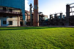 Empty grass with old steel steelworks of pipelines. Empty grass with old abandoned closed steel steelworks of pipelines Stock Photography