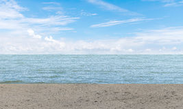 Empty gray concrete floor beside sea with blue sky background. Summer relaxing time Royalty Free Stock Images
