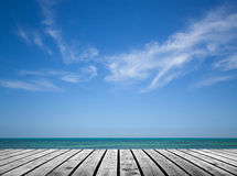 Empty gray wooden pier with sea and sky Stock Image