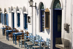 Empty greek cafè - Astypalea Island. Sunny day at Astypalea Chora - Dodecanese Islands  Greece Stock Images