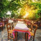 Empty greek tawern in the garden, Crete Stock Image