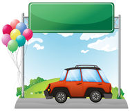 An empty green board above an orange jeep Royalty Free Stock Photos